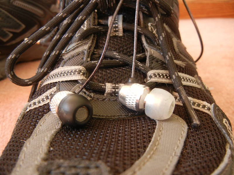 earbuds and running shoes